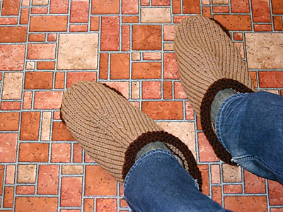 Felted clogs on recipient's feet