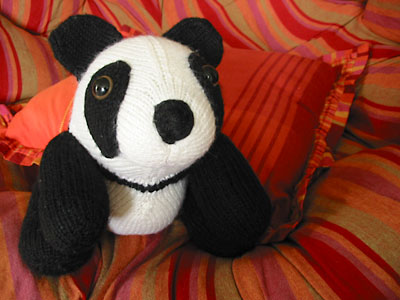 Finished panda toy, front view, sitting
