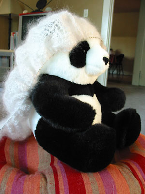 A bridal veil-slash-hairnet for a stuffed panda