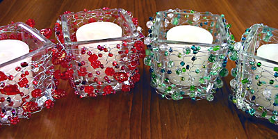 Red and green votive sleeves